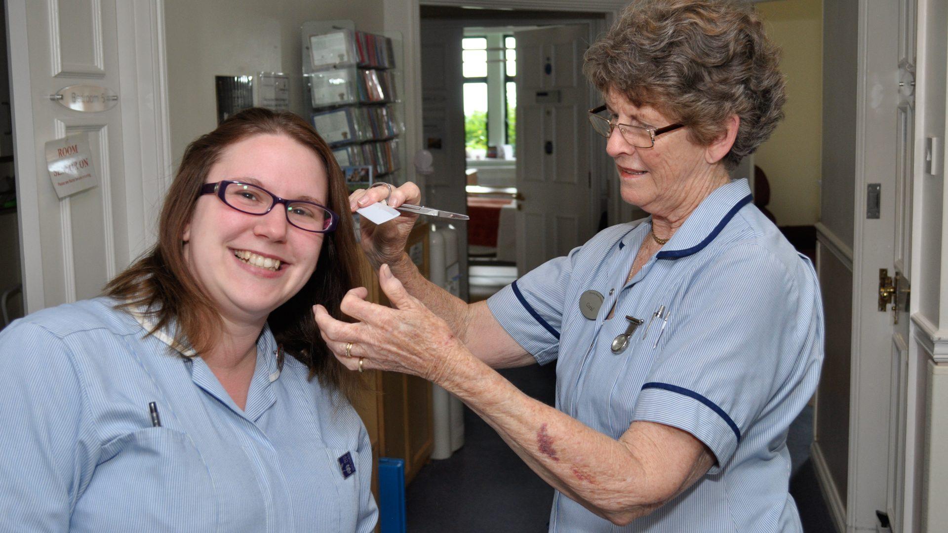 Nurse cutting hair